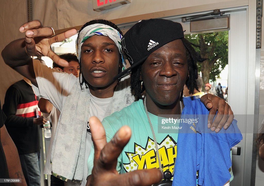 Rocky (L) and <a gi-track='captionPersonalityLinkClicked' href=/galleries/search?phrase=Flavor+Flav&family=editorial&specificpeople=171122 ng-click='$event.stopPropagation()'>Flavor Flav</a> pose backstage during the 2013 Budweiser Made In America Festival at Benjamin Franklin Parkway on August 31, 2013 in Philadelphia, Pennsylvania.