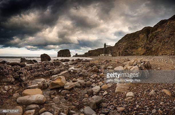 A Rocky Beach Along The Water's Edge