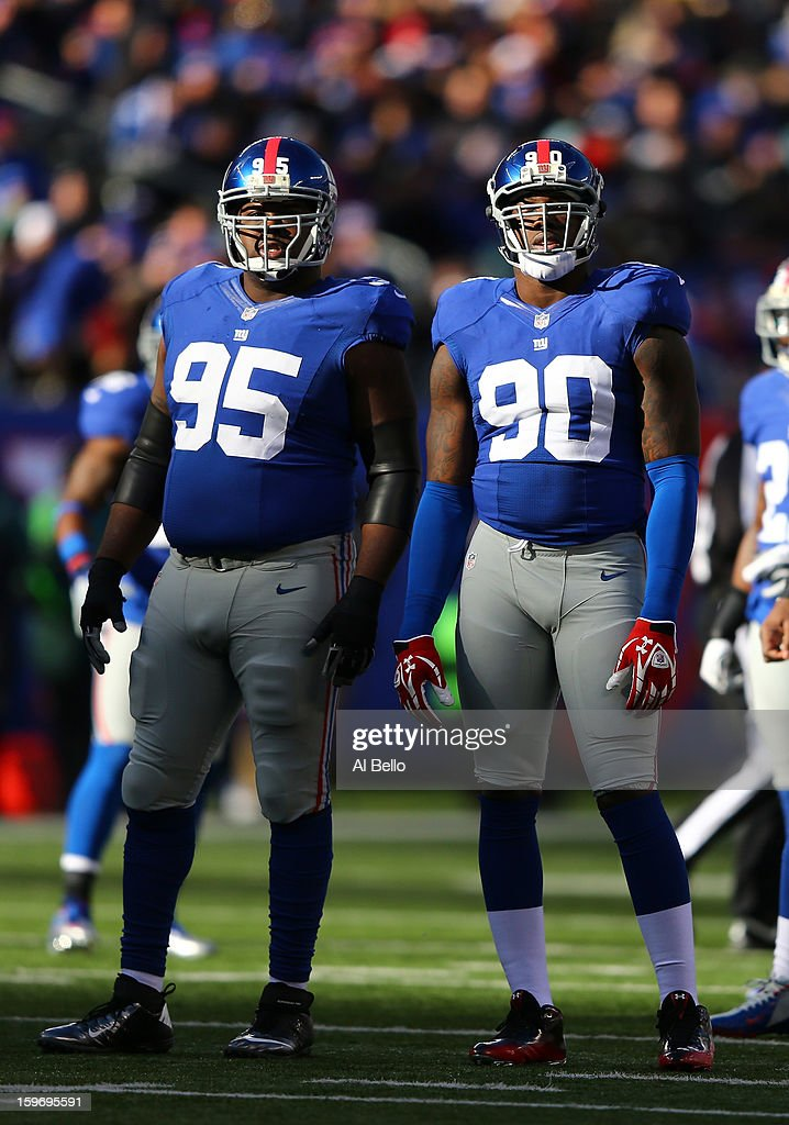 Rocky Bernard #95, and Jason Pierre-Paul #90 of the New York Giants in action during their game against the Philadelphia Eagles at MetLife Stadium on December 30, 2012 in East Rutherford, New Jersey.