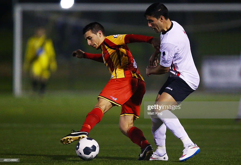 Rocky Callisto of Metrostars SC is challenged by Giorgio Speranza of Blacktown City during the FFA Cup match between Blacktown City FC and MetroStars...