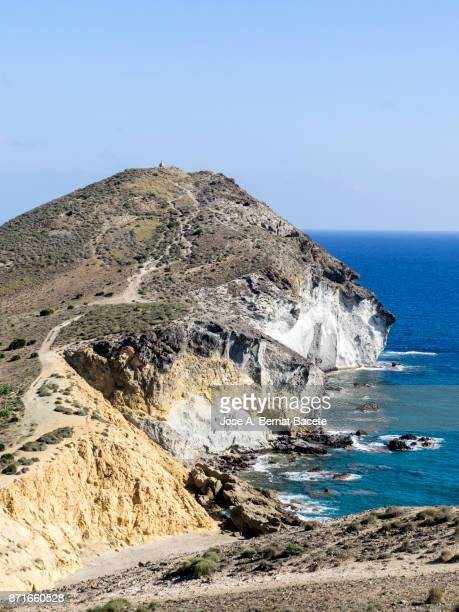 Rocky coast of the Cabo de Gata with formations of volcanic rock of yellow color.  Cabo de Gata - Nijar Natural Park, Cala the yellows, Beach, Biosphere Reserve, Almeria,  Andalusia, Spain