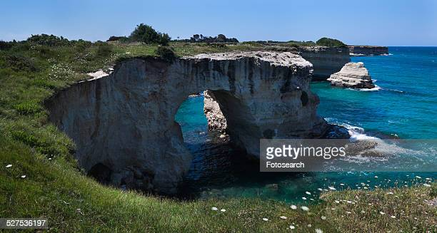 Rocky coastline and natural arch formation
