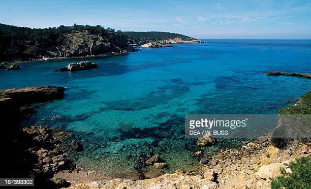 Rocky coastline around Cala Portinatx Ibiza Balearic Islands Spain