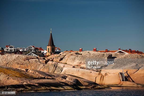 Rocky coastline with a church in Smögen, Sweden