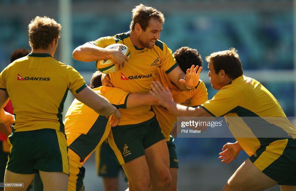 Rocky Elsom of the Wallabies is tackled during an Australian Wallabies training session at the Moses Mabhida Stadium on August 10 2011 in Durban...