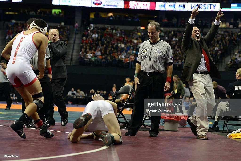 Rocky Ford head coach Ron Nordin celebrates as 126-pounder Adam Baca defeats Paonia's Bo Pipher 5-2 in the class 2A final during the Colorado State High School Wrestling Championships. The state's top wrestlers squared off in four classes in front of a near-capacity crowd at the Pepsi Center.