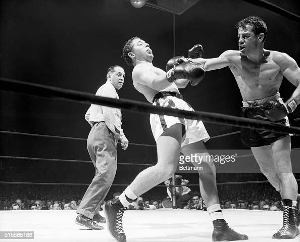 Rocky Graziano follows through after a hard right to the jaw of opponent Tony Janiro during their tenround fight at Madison Square Garden on October...