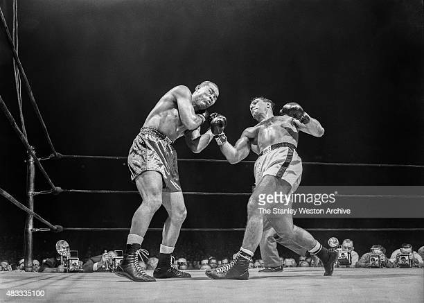Rocky Marciano and Joe Louis are trading blows during their scheduled tenround bout on October 26 1951 at Madison Square Garden in New York New York