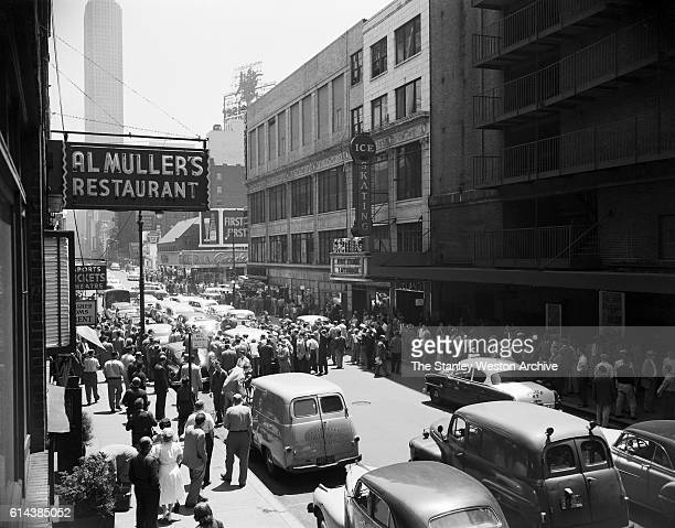 Rocky Marciano arrives with a street full of fans for the weighingin before his bout against Archie Moore in New York New York on September 21 1955