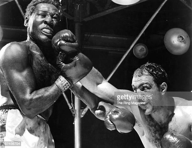 Rocky Marciano lands a right hook against Ezzard Charles during the fight at Yankee Stadium on September 171954 in Bronx New York Rocky Marciano won...