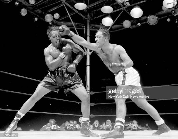 Rocky Marciano lunges with right as Archie Moore braces for blow
