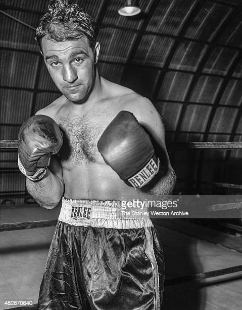 Rocky Marciano poses for the camera while training for title defense against Archie Moore at the Grossingers training camp in September 1955 in...