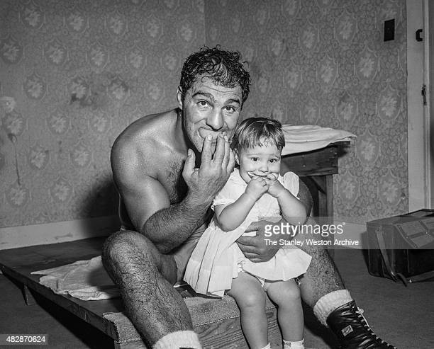 Rocky Marciano poses for the camera with daughter Mary Ann on Rocky's 32nd Birthday while training for title defense against Archie Moore Grossingers...