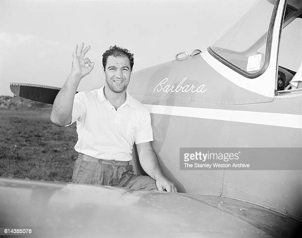 Rocky Marciano poses with his private airplane named after his wife Barbara during his time training for his title defense against Archie Moore at...
