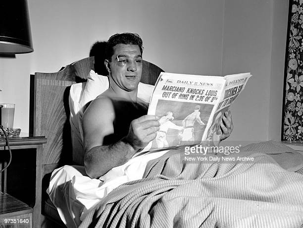Rocky Marciano reads the Daily News at the Belmont Plaza Hotel after defeating Joe Louis