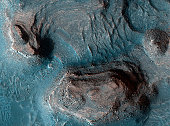 Mesas in the Nilosyrtis Mensae region of Mars appear in enhanced color in this image from the High Resolution Imaging Science Experiment (HiRISE) camera on NASA's Mars Reconnaissance Orbiter (MRO). Th