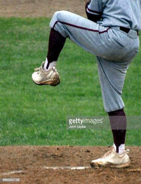 Rocky Mountain Kalen Hammer kicks his leg during warm ups as the rain comes down against Mountain Vista during the 2017 CHSAA Boys Baseball...