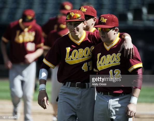 Rocky Mountain Lobos baseball players Spencer Ibarra center #47 and Trevor Bell #12 right celebrate their victory over Chaparral Wolverines at Coors...