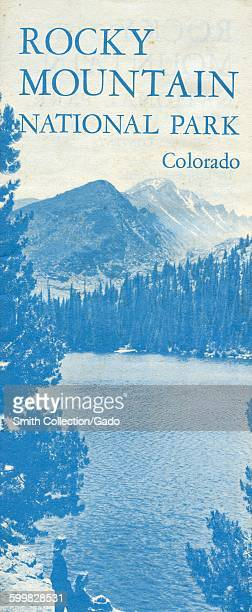 Rocky Mountain National Park travel brochure with bluetoned image of rocky mountain peaks and tourists sitting near a lake and forest 1963