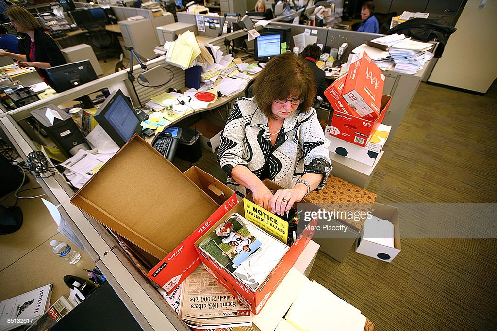 Rocky Mountain News courts reporter Sue Lindsay packs up a box with some of her personal belongings at the newspaper's offices February 26, 2009 in Denver, Colorado. Scripps executives announced to employees that tomorrow's edition of the News would be its last after almost 150 years of publishing. The newspaper had been put up for sale by Scripps, but the search for a buyer proved unsuccessful. The closure will cost 228 newsroom employees their jobs.