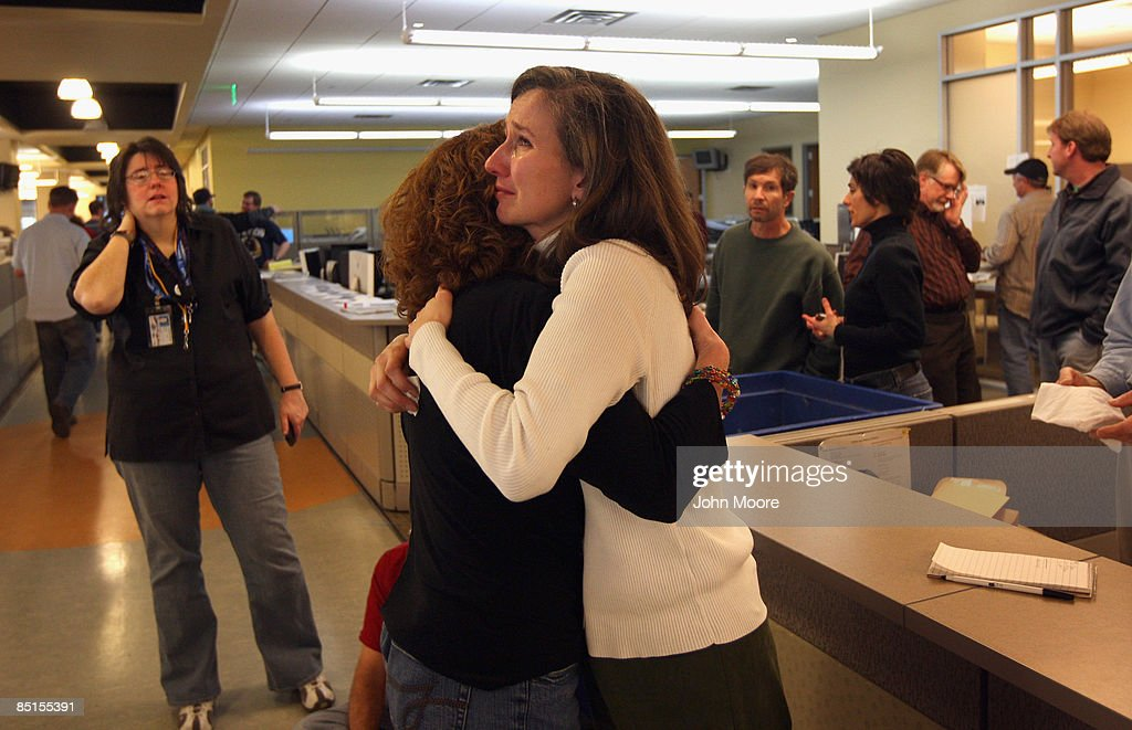 Rocky Mountain News reporter Laura Frank hugs a fellow staffer in the newsroom on their last day of work on February 27, 2009 in Denver, Colorado. Friday's edition was the last for the nearly 150-year-old daily, Colorado's oldest newspaper. The owner E.W. Scripps Co. announced Thursday that the paper was closing down after efforts to sell the money-losing newspaper failed. About 200 Rocky staffers lost their jobs in the closing.