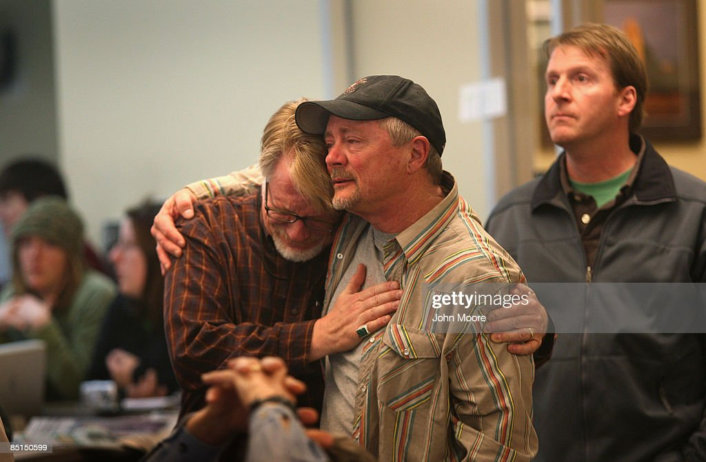 Rocky Mountain News staffers Dean Krakel (C), and Randall Roberts embrace in the newsroom on February 27, 2009 in Denver, Colorado. Today's edition was the last for the nearly 150-year-old daily, Colorado's oldest newspaper. Parent company E.W. Scripps Co. announced yesterday that the paper would close after efforts to find a buyer failed. Krakel was the News' director of photography and Roberts the administrative editor.