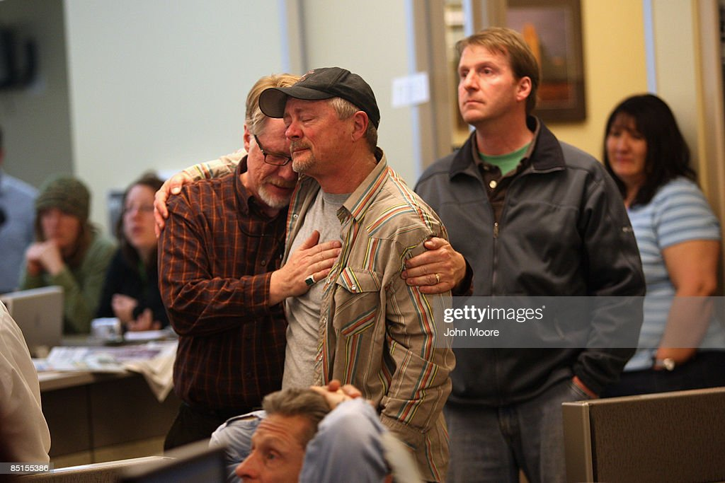 Rocky Mountain News staffers Dean Krakel (C) and Randall Roberts embrace in the newsroom on February 27, 2009 in Denver, Colorado. Friday's edition was the last for the nearly 150-year-old daily, Colorado's oldest newspaper. The owner E.W. Scripps Co. announced Thursday that the paper was closing down after efforts to sell the money-losing newspaper failed. About 200 Rocky staffers lost their jobs in the closing. Krakel was the Rocky's director of photography and Roberts the administrative editor.