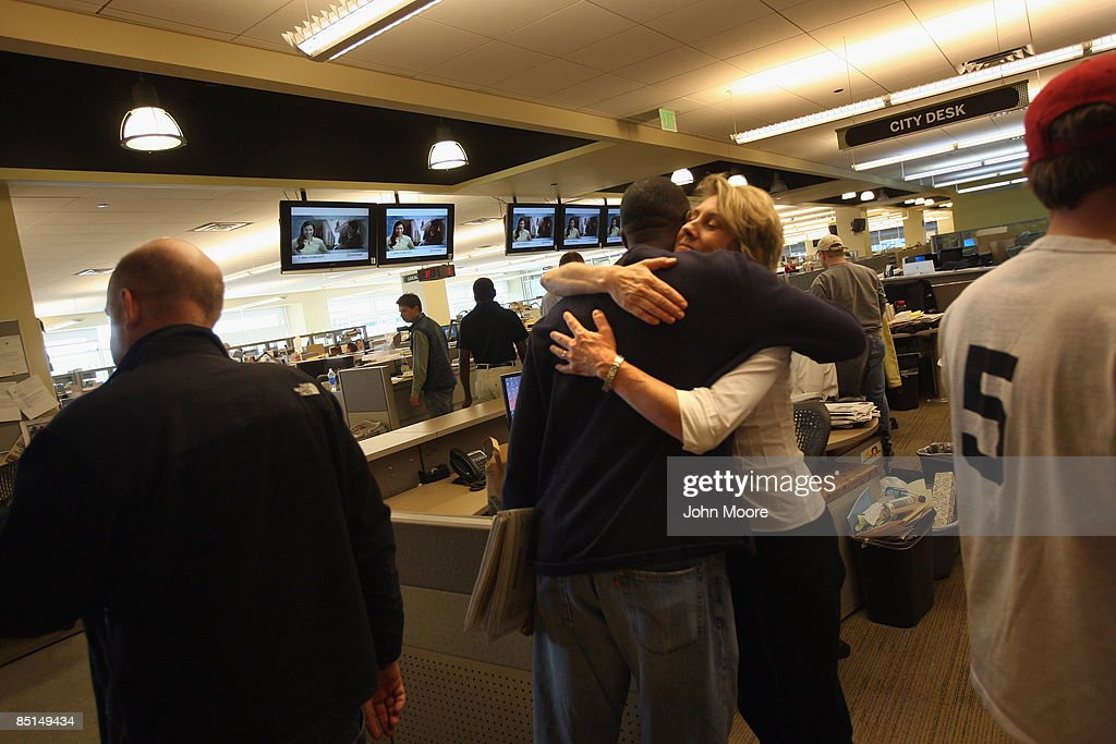 Rocky Mountain News staffers embrace before leaving the newsroom on their last day of work on February 27, 2009 in Denver, Colorado. Today's edition was the last for the nearly 150-year-old daily, Colorado's oldest newspaper. Parent company E.W. Scripps Co. announced yesterday that the paper would close after efforts to find a buyer failed. Some 200 staffers lost their jobs.