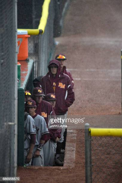 Rocky Mountain players look on from the dugout as rain falls during their game against Mountain Vista during the 2017 CHSAA Boys Baseball...