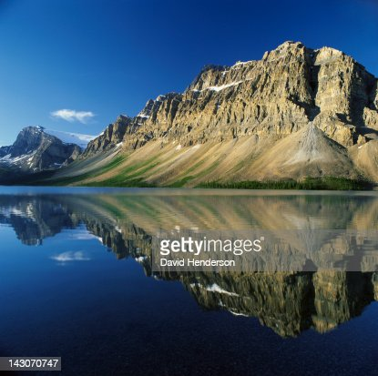Rocky mountains reflected in still lake