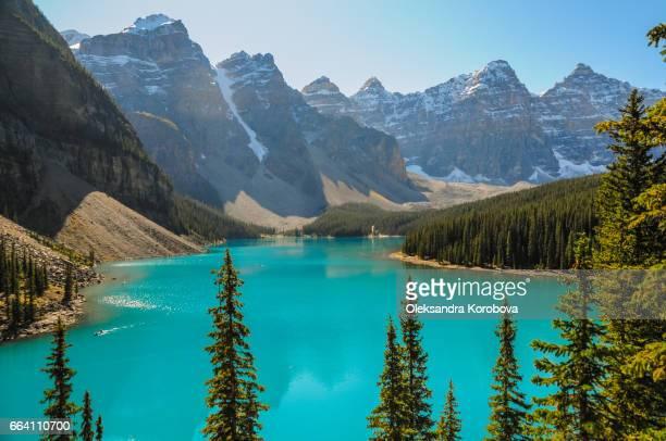 Rocky Mountains reflecting in Lake Moraine, Alberta, Canada.