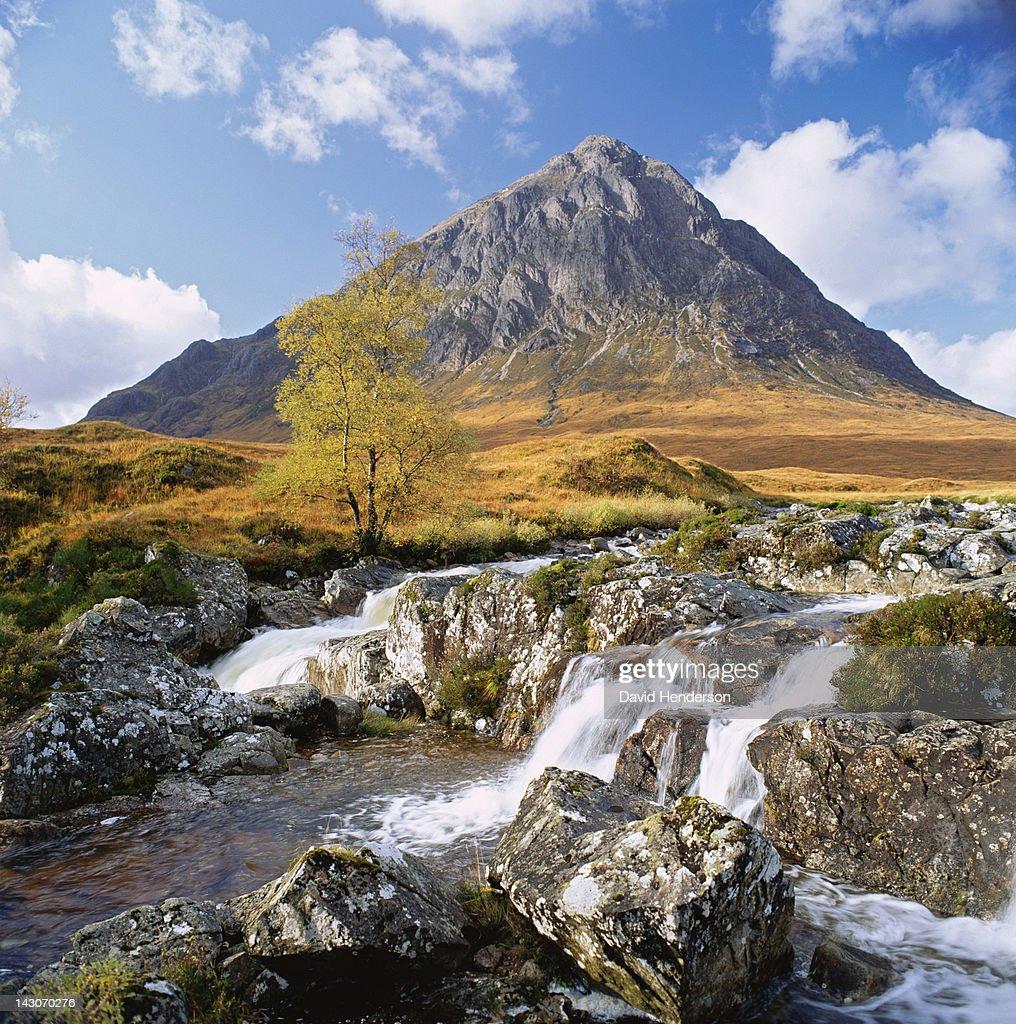 Rocky river in rural landscape : Stock Photo