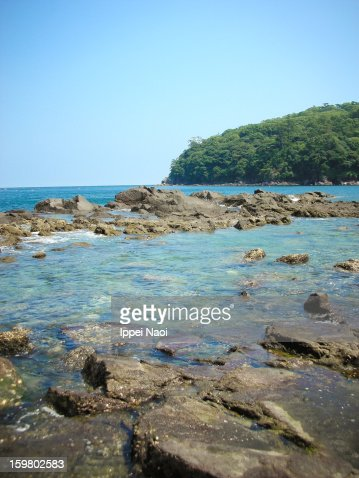 Rocky seaside with clear water : Stock Photo