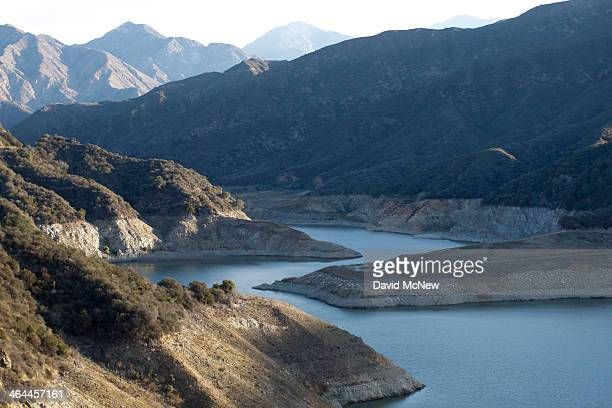 Rocky shores are exposed by the low waters of San Gabriel Reservoir on the San Gabriel River in the Angeles National Forest on January 22 2014 in...