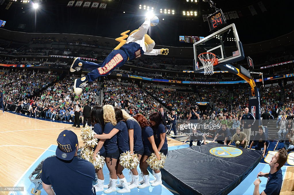 Rocky the Denver Nuggets mascot dunks the ball during halftime of the game against the Los Angeles Clippers on March 17, 2014 at the Pepsi Center in Denver, Colorado.