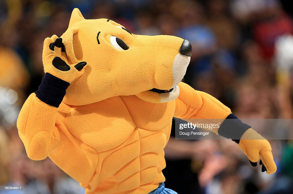 Rocky, the mascot of the Denver Nuggets, encourages the fans as he supports his team against the Oklahoma City Thunder at the Pepsi Center on March 1, 2013 in Denver, Colorado. The Nuggets defeated the Thunder 105-103.