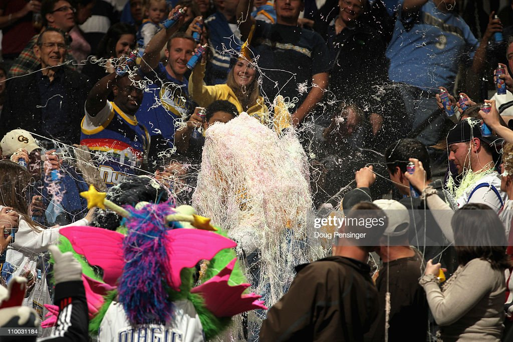 Rocky, the mascot of the Denver Nuggets is coated in silly string by the fans as they celebrate his birthday as the Nuggets host the Detroit Pistons at the Pepsi Center on March 12, 2011 in Denver, Colorado. The Nuggets defeated the Pistons 131-101.