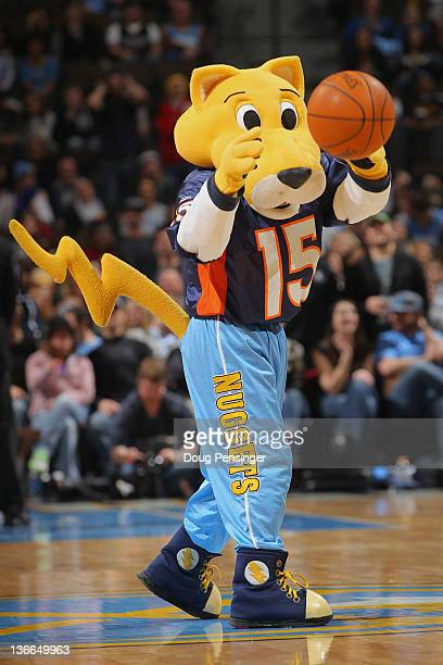Rocky the mascot of the Denver Nuggets wears a Tim Tebow Denver Broncos jersey as he entertains the crowd during a break in the action against the...