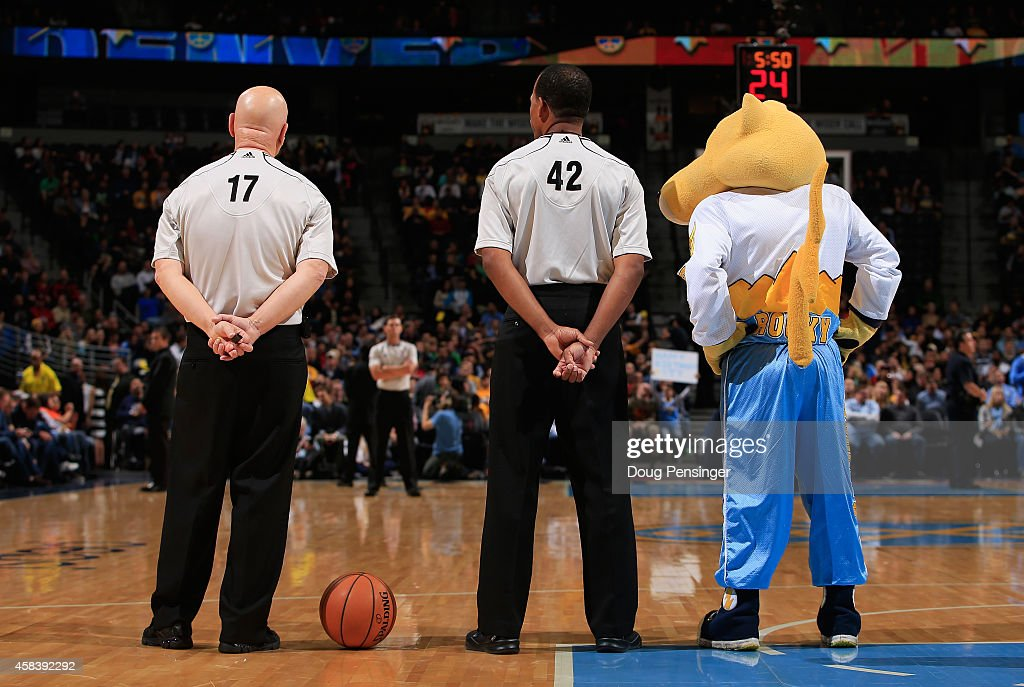 Rocky the mascot stands with referee Joe Crawford and referee Eric Lewis during a break in the action between the Sacramento Kings and the Denver...
