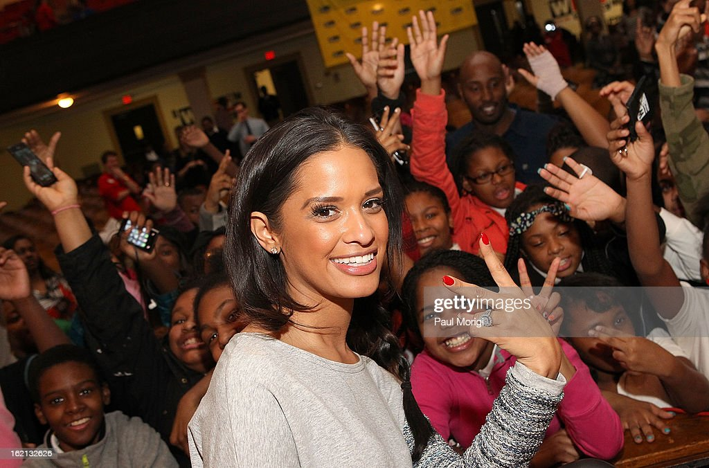 Rocsi Diaz poses for a photo with Browne Education Campus students during the Get Schooled Victory Tour on February 19, 2013 in Washington, DC.