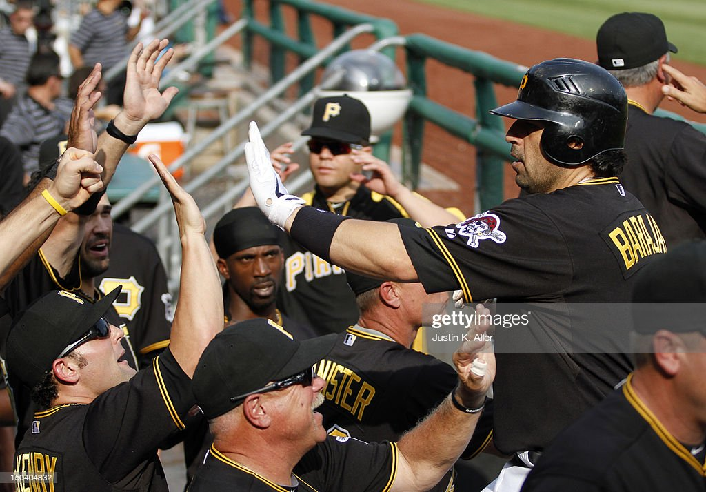 <a gi-track='captionPersonalityLinkClicked' href=/galleries/search?phrase=Rod+Barajas&family=editorial&specificpeople=211198 ng-click='$event.stopPropagation()'>Rod Barajas</a> #26 of the Pittsburgh Pirates celebrates after scoring in the fourth inning against the Los Angeles Dodgers during the game on August 16, 2012 at PNC Park in Pittsburgh, Pennsylvania.