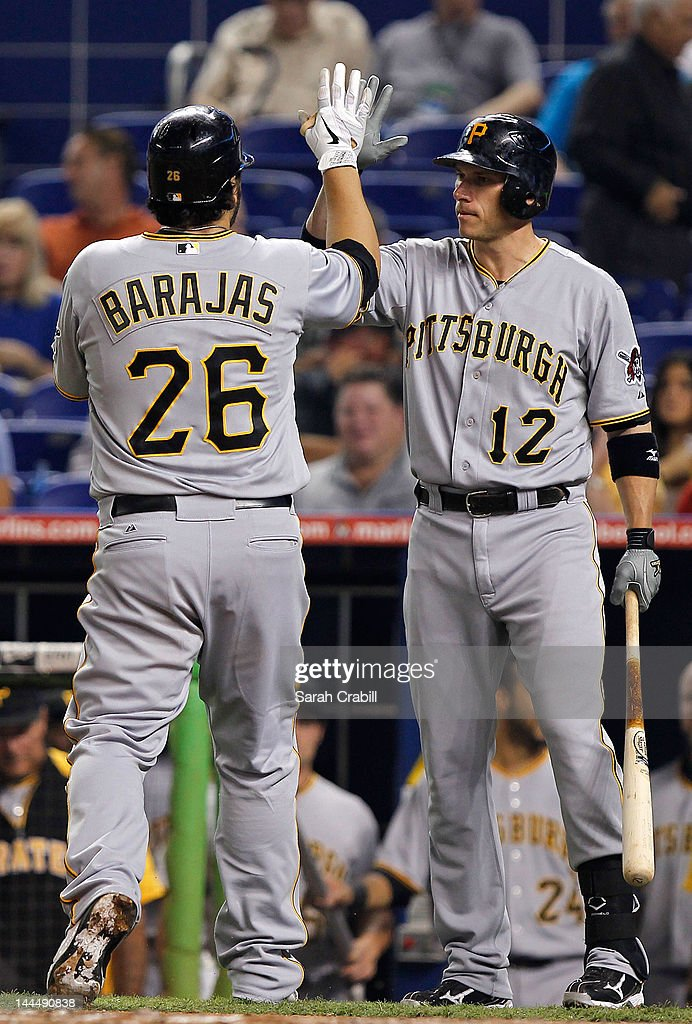 <a gi-track='captionPersonalityLinkClicked' href=/galleries/search?phrase=Rod+Barajas&family=editorial&specificpeople=211198 ng-click='$event.stopPropagation()'>Rod Barajas</a> #26 of the Pittsburgh Pirates celebrates with <a gi-track='captionPersonalityLinkClicked' href=/galleries/search?phrase=Clint+Barmes&family=editorial&specificpeople=208223 ng-click='$event.stopPropagation()'>Clint Barmes</a> #12 after hitting a home run during a game against the Miami Marlins at Marlins Park on May 14, 2012 in Miami, Florida.
