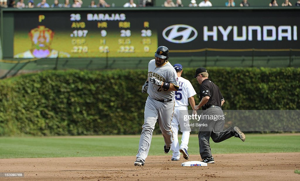 <a gi-track='captionPersonalityLinkClicked' href=/galleries/search?phrase=Rod+Barajas&family=editorial&specificpeople=211198 ng-click='$event.stopPropagation()'>Rod Barajas</a> #26 of the Pittsburgh Pirates hits a two-run homer against the Chicago Cubs in the second inning on September 16, 2012 at Wrigley Field in Chicago, Illinois.