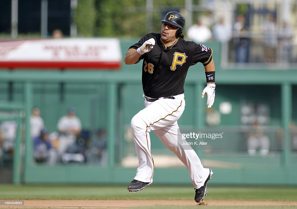 <a gi-track='captionPersonalityLinkClicked' href=/galleries/search?phrase=Rod+Barajas&family=editorial&specificpeople=211198 ng-click='$event.stopPropagation()'>Rod Barajas</a> #26 of the Pittsburgh Pirates rounds second in the fourth inning on a RBI triple by Clint Barmes #12 (not pictured) against the Los Angeles Dodgers during the game on August 16, 2012 at PNC Park in Pittsburgh, Pennsylvania.