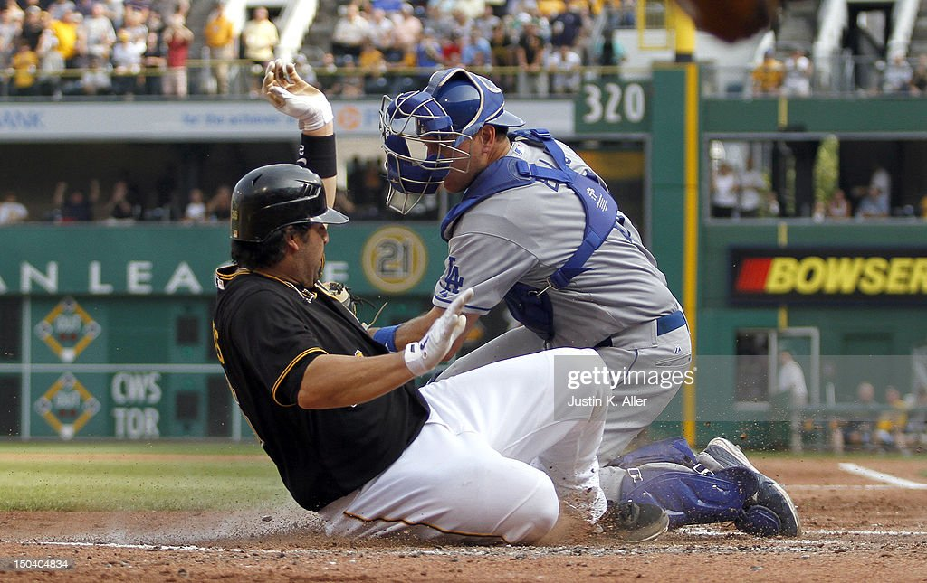 <a gi-track='captionPersonalityLinkClicked' href=/galleries/search?phrase=Rod+Barajas&family=editorial&specificpeople=211198 ng-click='$event.stopPropagation()'>Rod Barajas</a> #26 of the Pittsburgh Pirates slides in safe against A.J. Ellis #17 of the Los Angeles Dodgers in the fourth inning during the game on August 16, 2012 at PNC Park in Pittsburgh, Pennsylvania.