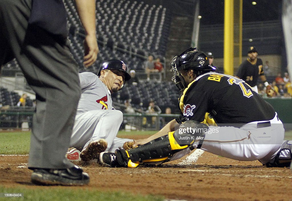 <a gi-track='captionPersonalityLinkClicked' href=/galleries/search?phrase=Rod+Barajas&family=editorial&specificpeople=211198 ng-click='$event.stopPropagation()'>Rod Barajas</a> #26 of the Pittsburgh Pirates tags out <a gi-track='captionPersonalityLinkClicked' href=/galleries/search?phrase=Kyle+Lohse&family=editorial&specificpeople=218037 ng-click='$event.stopPropagation()'>Kyle Lohse</a> #26 of the St. Louis Cardinals during the game on August 27, 2012 at PNC Park in Pittsburgh, Pennsylvania.