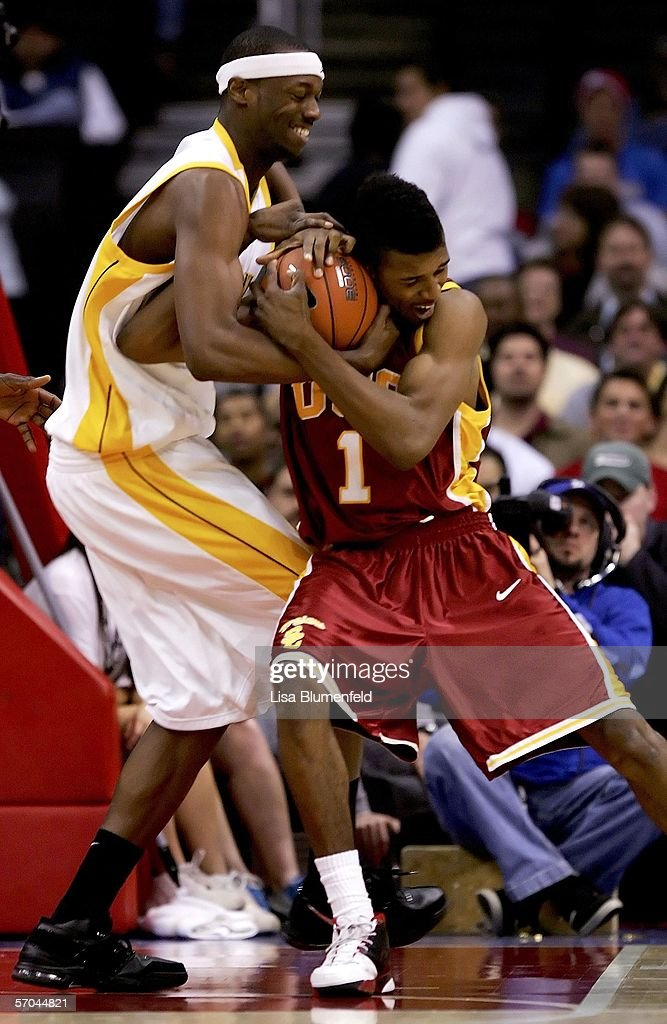 Rod Benson #0 of the California Golden Bears and Nick Young #1 of the USC Trojans battle for possession of the ball during the quarterfinals of the 2006 Pacific Life Pac-10 Men's Basketball Tournament on March 9, 2006 at Staples Center in Los Angeles, California.