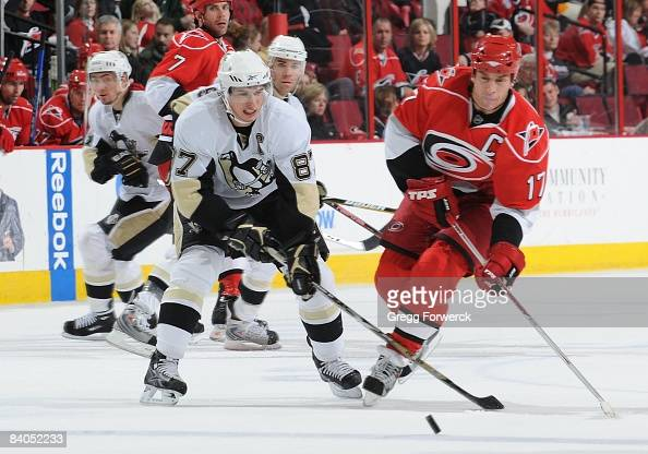 Rod Brind'Amour of the Carolina Hurricanes battles for the puck with Sidney Crosby of the Pittsburgh Penguins during a NHL game on November 23 2008...