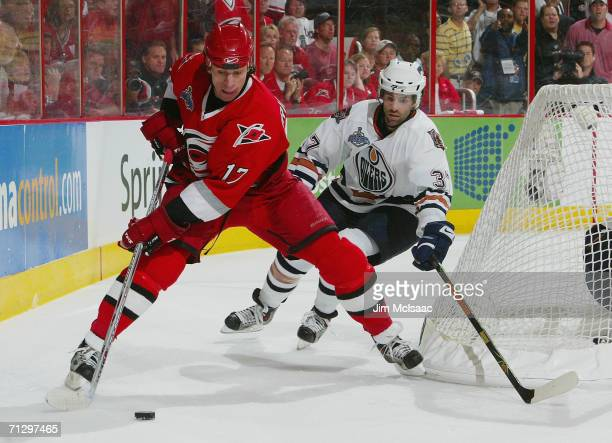 Rod Brind'Amour of the Carolina Hurricanes controls the puck against Michael Peca of the Edmonton Oilers during game seven of the 2006 NHL Stanley...