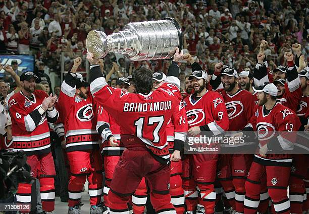 Rod Brind'Amour of the Carolina Hurricanes hoists the Stanley Cup in front of his teammates after the Hurricanes defeated the Edmonton Oilers in game...